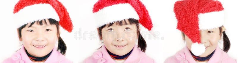 Ragazza dell'Asia con il cappello di natale immagini stock libere da diritti