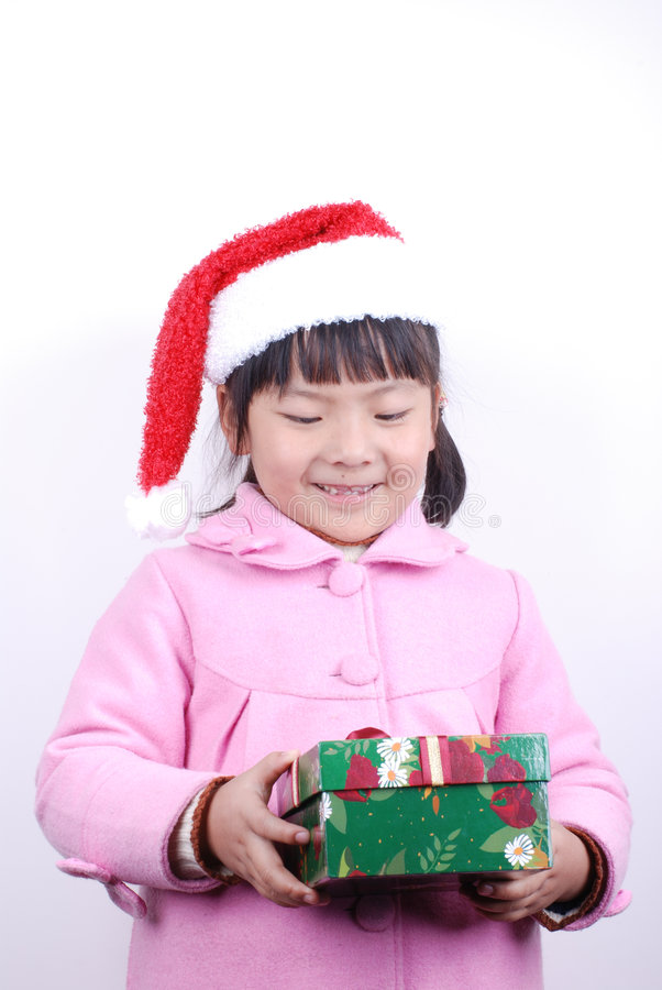 Ragazza dell'Asia con il regalo in mani immagine stock