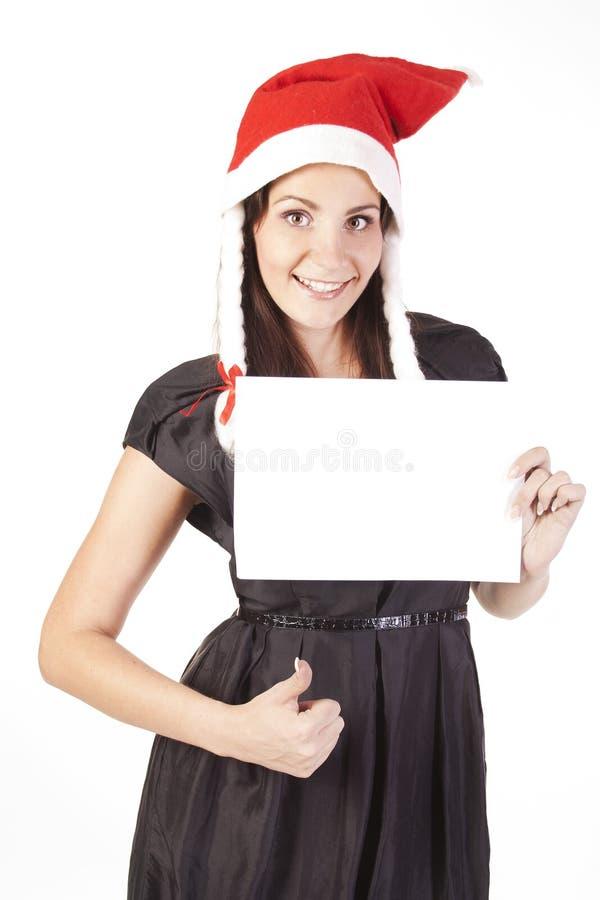 Ragazza della Santa che mostra a mano segno giusto con uno spazio in bianco fotografie stock