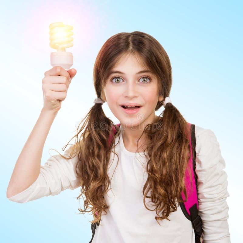 Ragazza della scuola con la nuova idea immagine stock libera da diritti