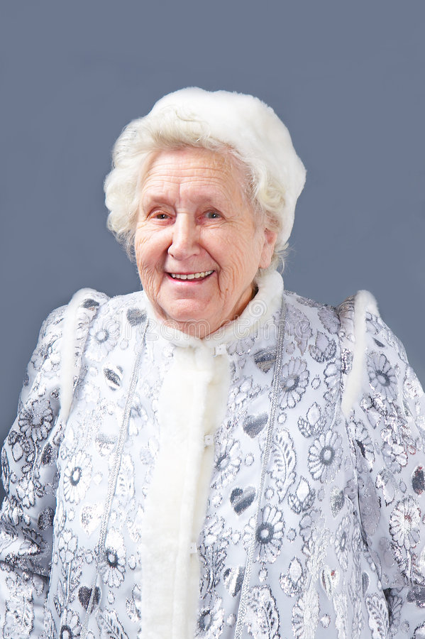 Ragazza della signora anziana neve fotografie stock