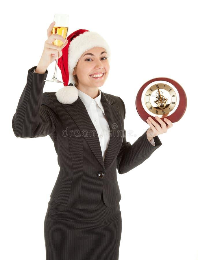 Ragazza di affari in cappello della Santa e con champagne fotografia stock