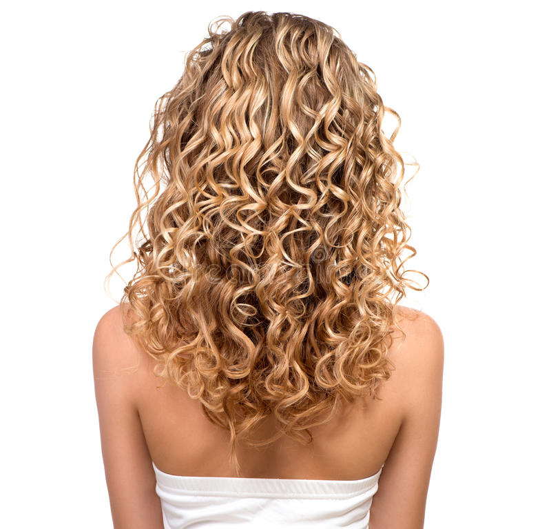 Ragazza di bellezza con capelli permed bionda fotografia stock