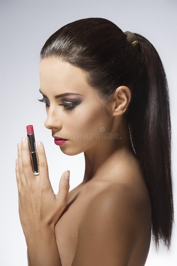 Ragazza di bellezza con rossetto fotografie stock libere da diritti