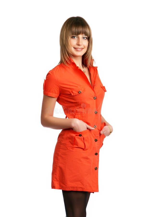 Ragazza di Glamor in un vestito arancione isolato fotografia stock libera da diritti