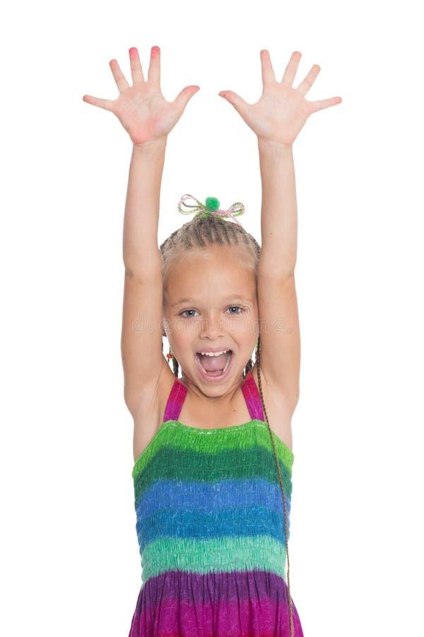 Ragazza di grido con le sue mani del ‹del †del ‹del †sollevate fotografia stock libera da diritti