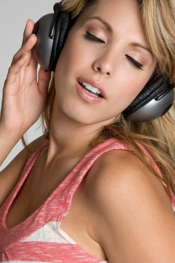 Ragazza di musica delle cuffie fotografie stock libere da diritti