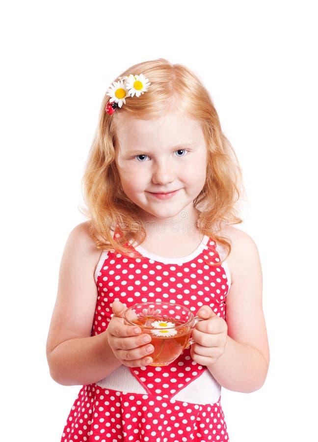 Ragazza di sorriso con la tazza di tè immagine stock