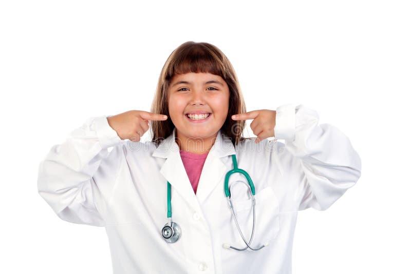 Ragazza divertente con l'uniforme di medico immagine stock