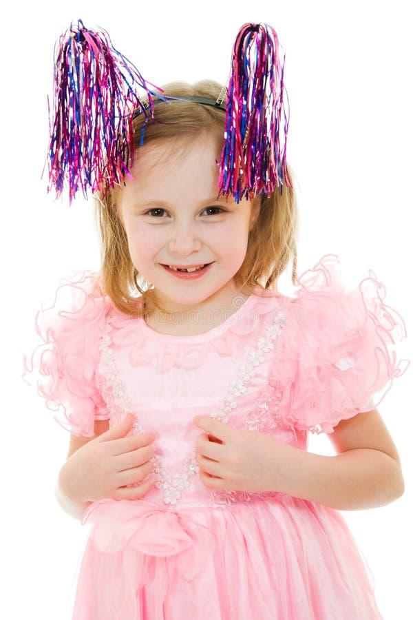 Ragazza divertente in un vestito dentellare con le antenne fotografia stock