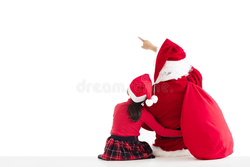 ragazza e Santa Claus che indicano il fondo bianco immagini stock