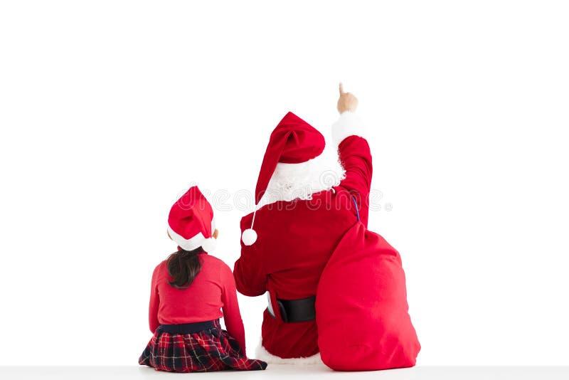 ragazza e Santa Claus che indicano il fondo bianco fotografie stock
