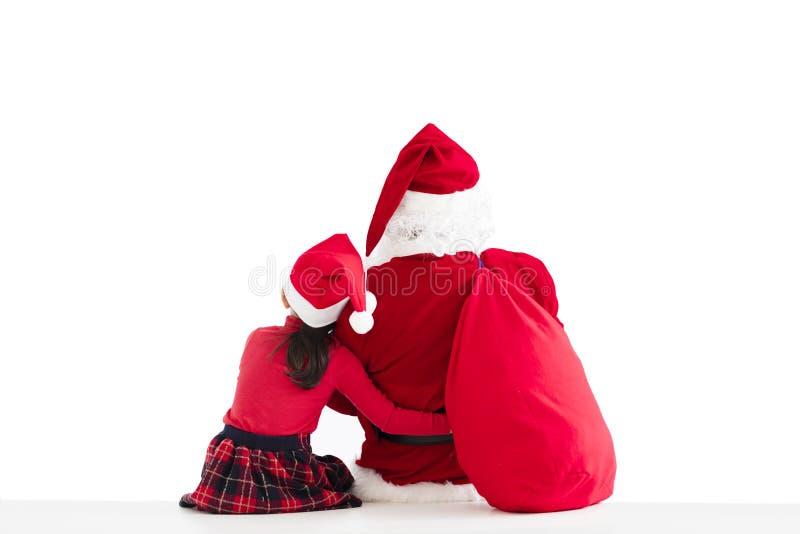 ragazza e Santa Claus che indicano il fondo bianco immagine stock