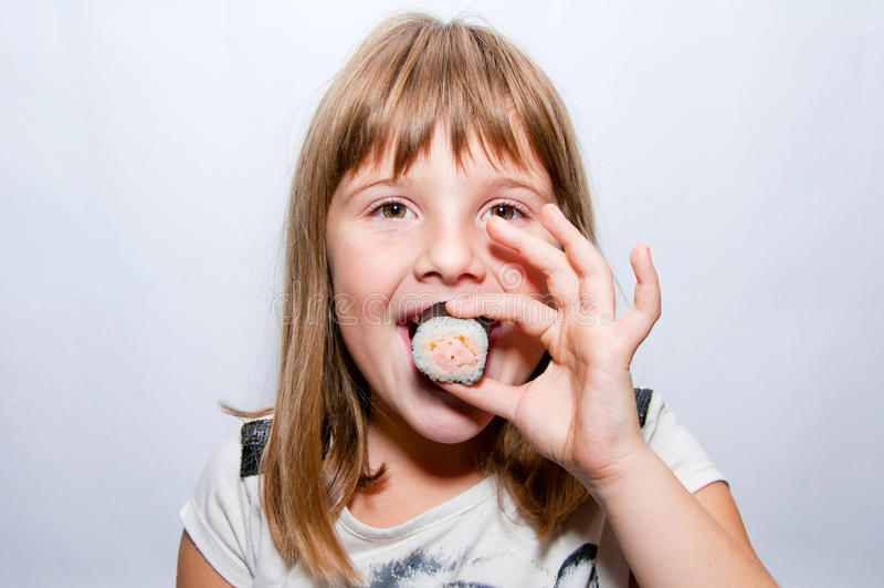Ragazza e sushi fotografia stock libera da diritti