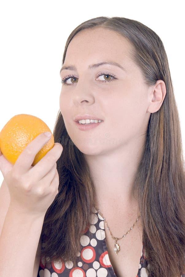 Ragazza ed arancio immagine stock libera da diritti