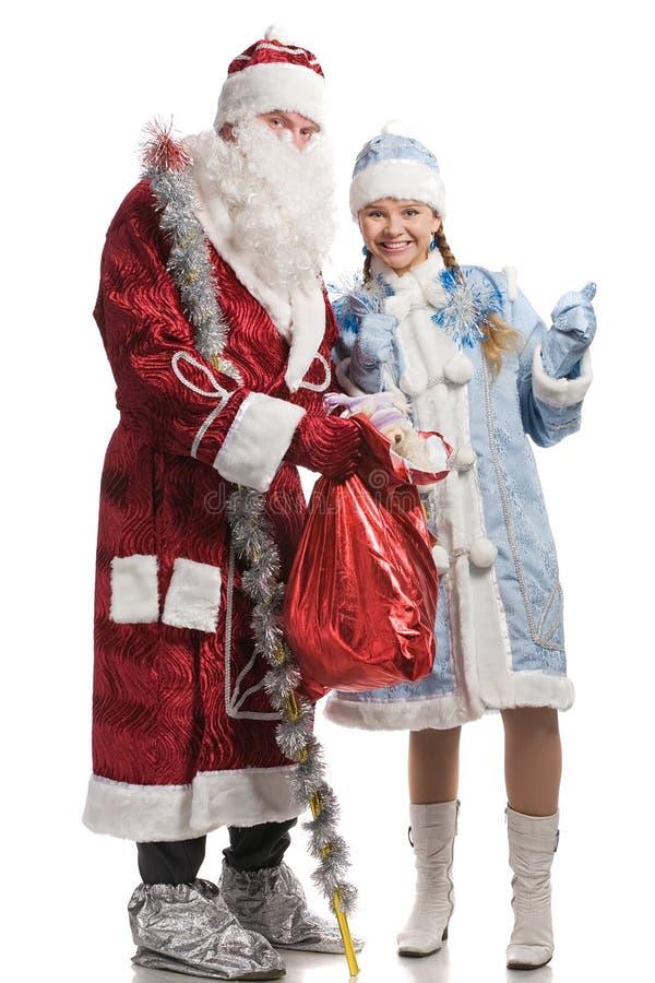 Ragazza ed il Babbo Natale sorridenti della neve fotografia stock libera da diritti