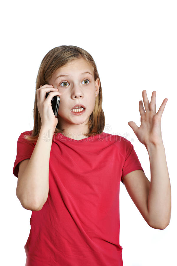 Ragazza emozionale che parla sul telefono fotografia stock libera da diritti