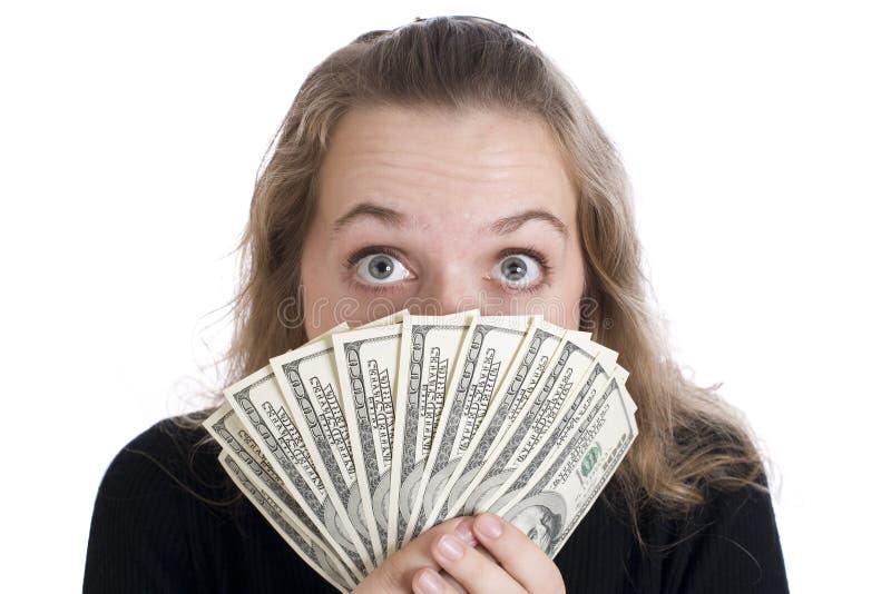 Ragazza espressiva con le fatture del dollaro immagine stock