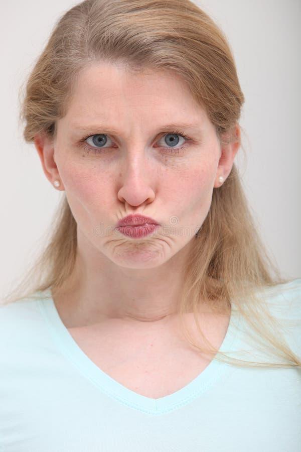 Ragazza facente il broncio con capelli biondi fotografie stock