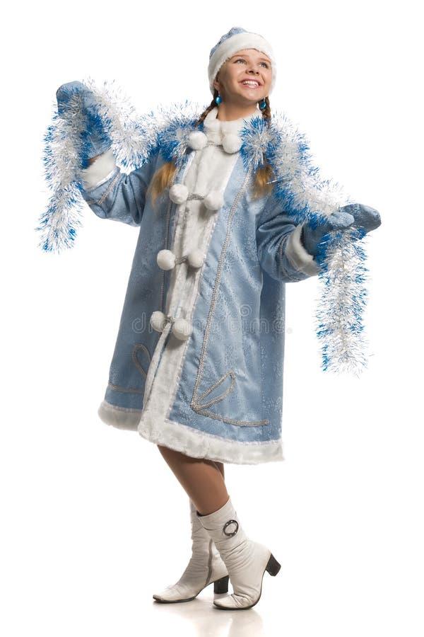 Ragazza felice in cappotto di pelliccia nubile della neve con canutiglia fotografia stock