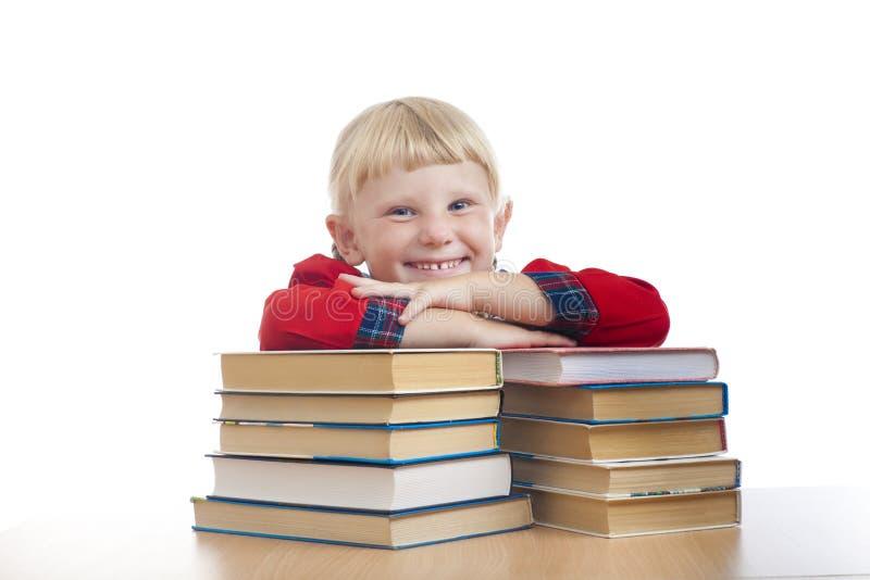 Ragazza felice con i libri fotografia stock libera da diritti