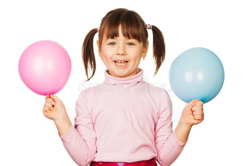 Ragazza felice con i palloni immagine stock