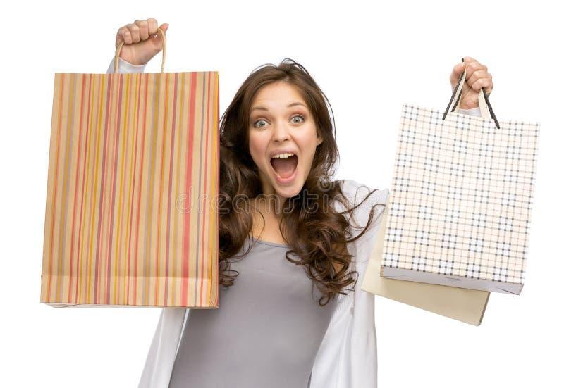 Ragazza felice con i sacchetti della spesa fotografia stock libera da diritti