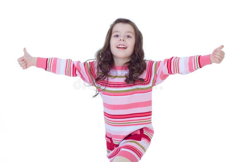 Ragazza felice del bambino con i pollici delle mani su fotografie stock libere da diritti