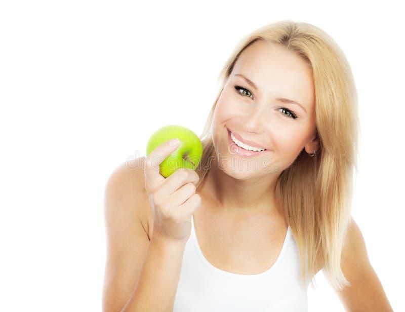 Ragazza graziosa che mangia mela fotografie stock libere da diritti