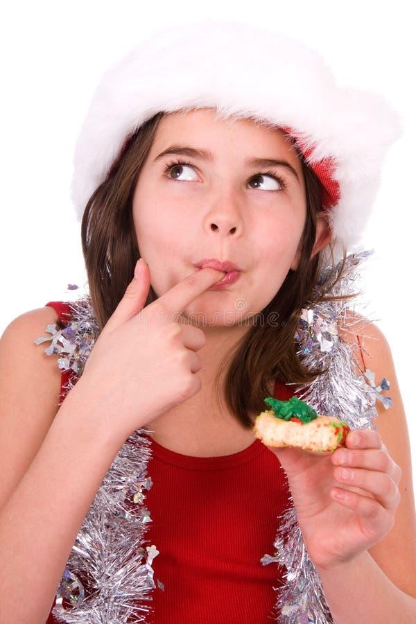 Ragazza graziosa con il biscotto. fotografie stock