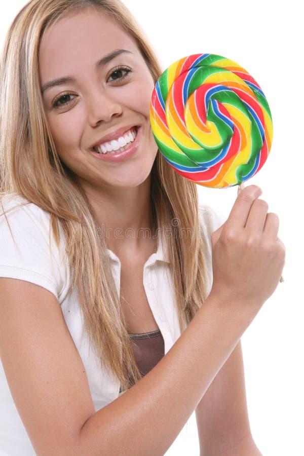 Ragazza graziosa con il Lollipop fotografia stock
