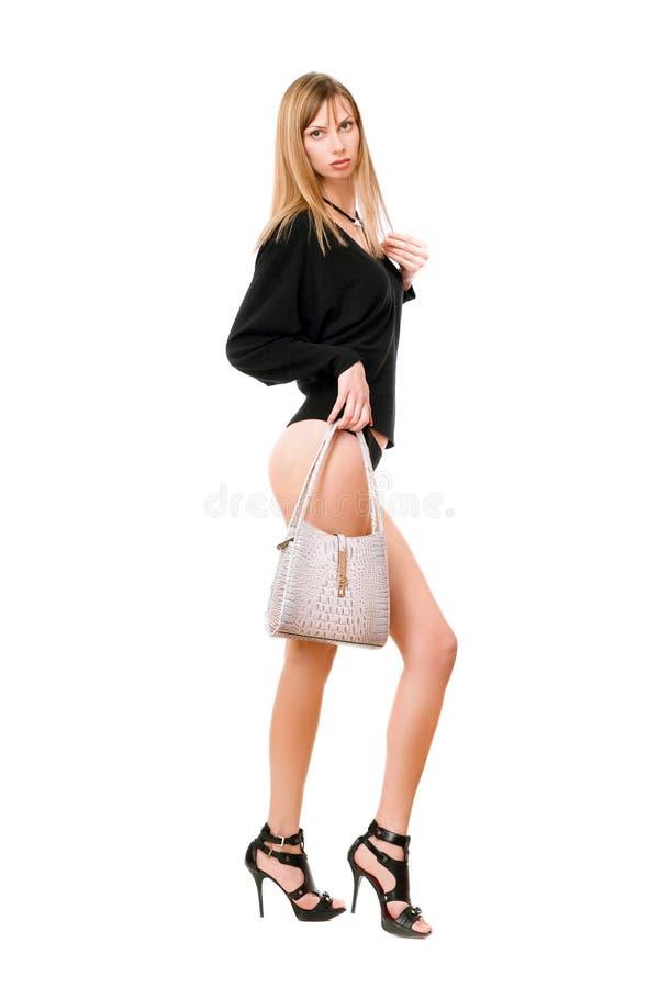 Ragazza graziosa con la borsa bianca immagini stock libere da diritti