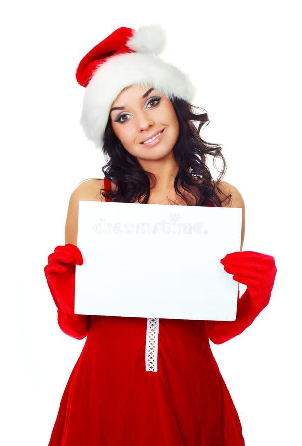 Ragazza graziosa con un foglio di carta in bianco immagini stock libere da diritti