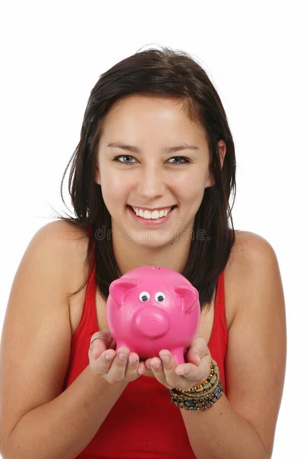 Ragazza graziosa e Piggybank fotografia stock libera da diritti