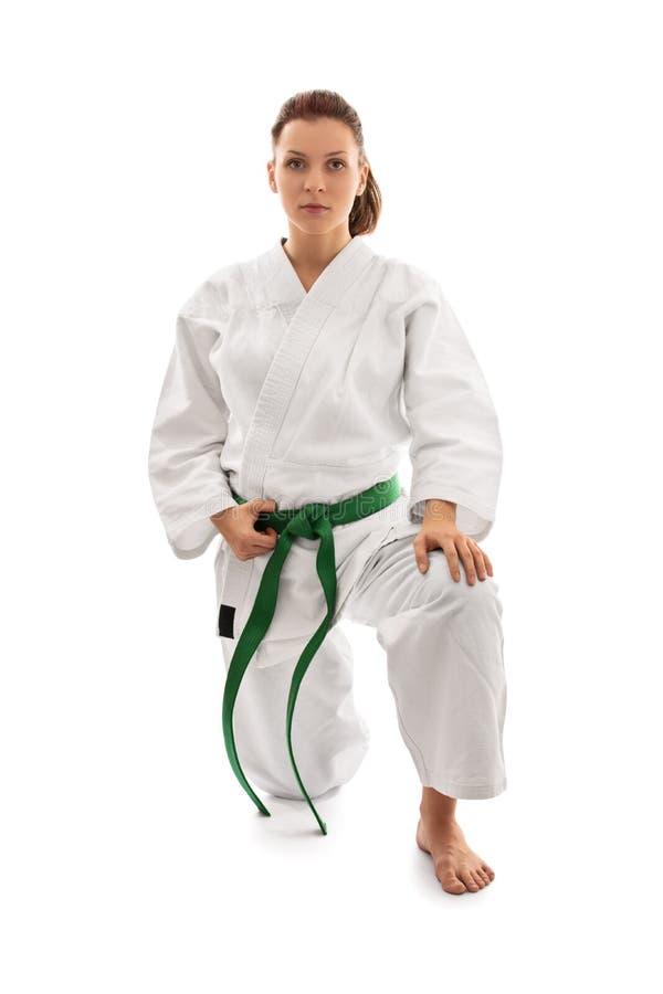 Ragazza in kimono sul suo ginocchio fotografie stock libere da diritti
