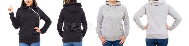 Ragazza in maglia con cappuccio nera alla moda isolata su fondo bianco: ragazza nella parte anteriore grigia del cappuccio e nell immagini stock