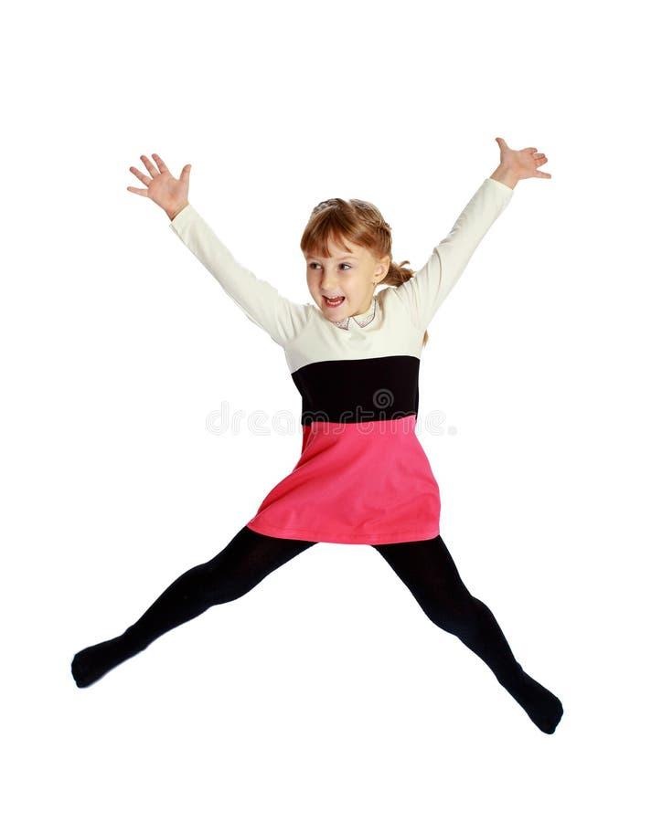 Ragazza nei salti a strisce rossi di un vestito immagini stock