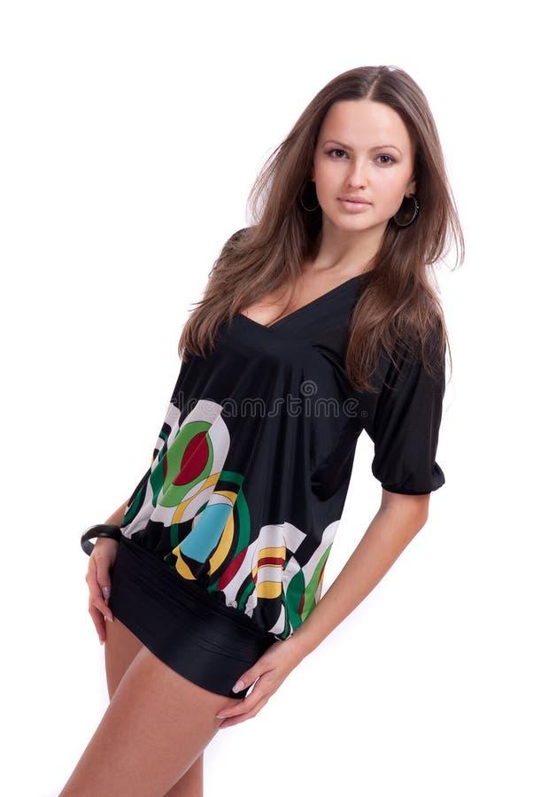 Ragazza nel nero, vestito da short fotografia stock