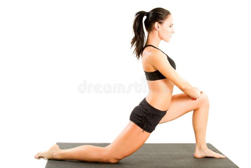 Ragazza nella posa di yoga fotografia stock libera da diritti