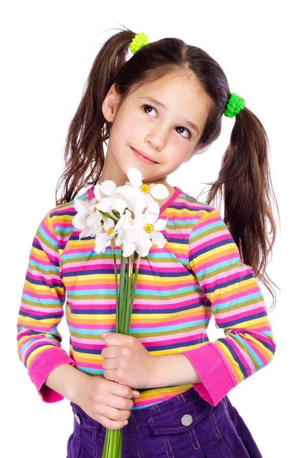 Ragazza Pensive con i daffodils bianchi fotografie stock