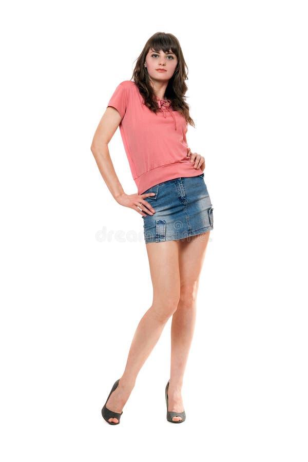 Ragazza piacevole in mini pannello esterno dei jeans immagini stock
