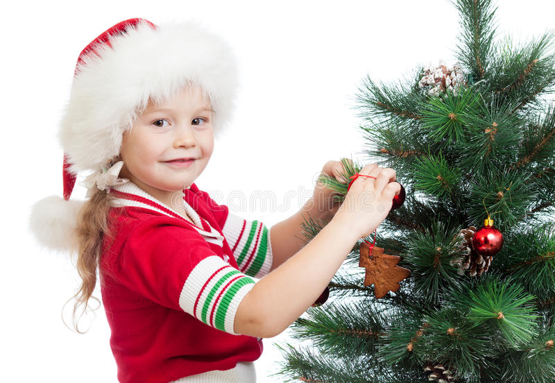 Ragazza prescolare graziosa che decora l'albero di Christas fotografia stock