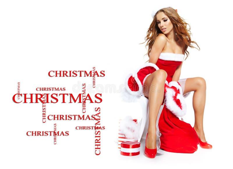 Ragazza sexy che indossa i vestiti del Babbo Natale immagini stock