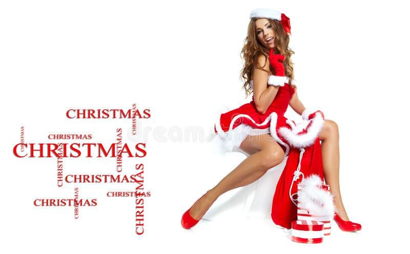 Ragazza sexy che indossa i vestiti del Babbo Natale fotografia stock