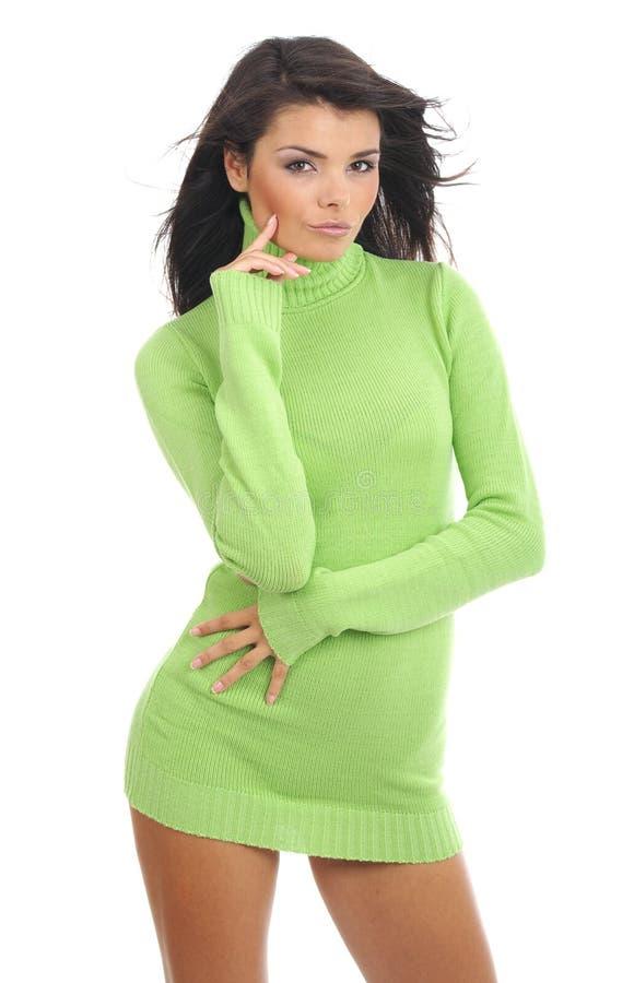 Ragazza sexy che porta maglione verde fotografie stock libere da diritti