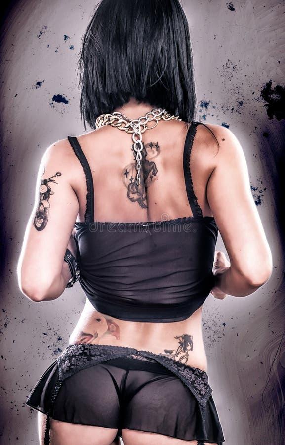 Ragazza sexy del tatuaggio di lerciume fotografia stock