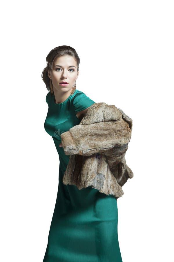 Ragazza sexy in un cappotto di pelliccia fotografie stock libere da diritti