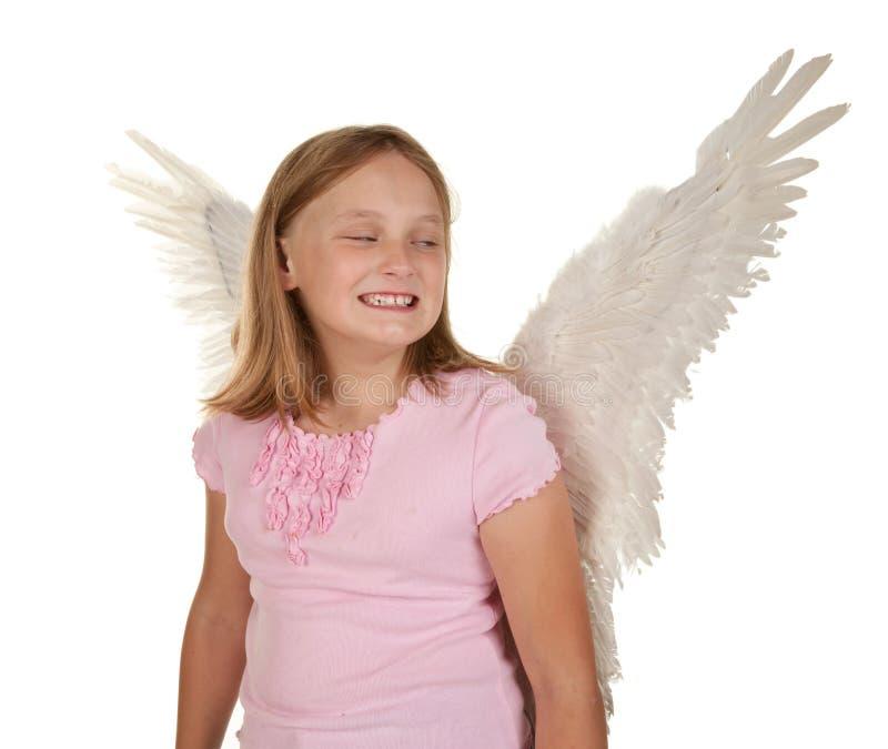 Ragazza Sneaky con le ali di angelo fotografie stock