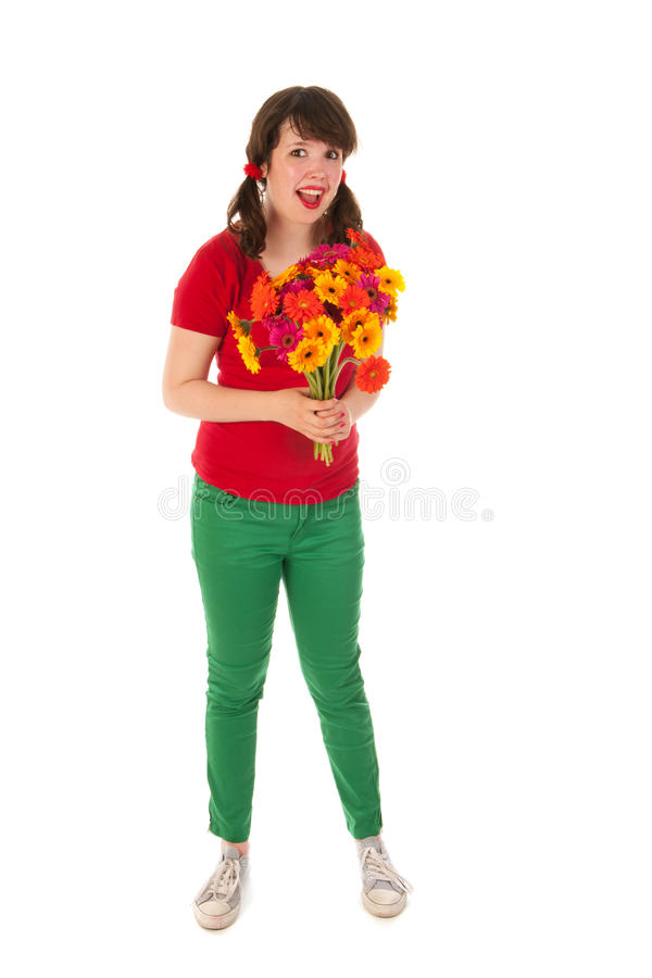 Ragazza soddisfatta dei fiori fotografie stock
