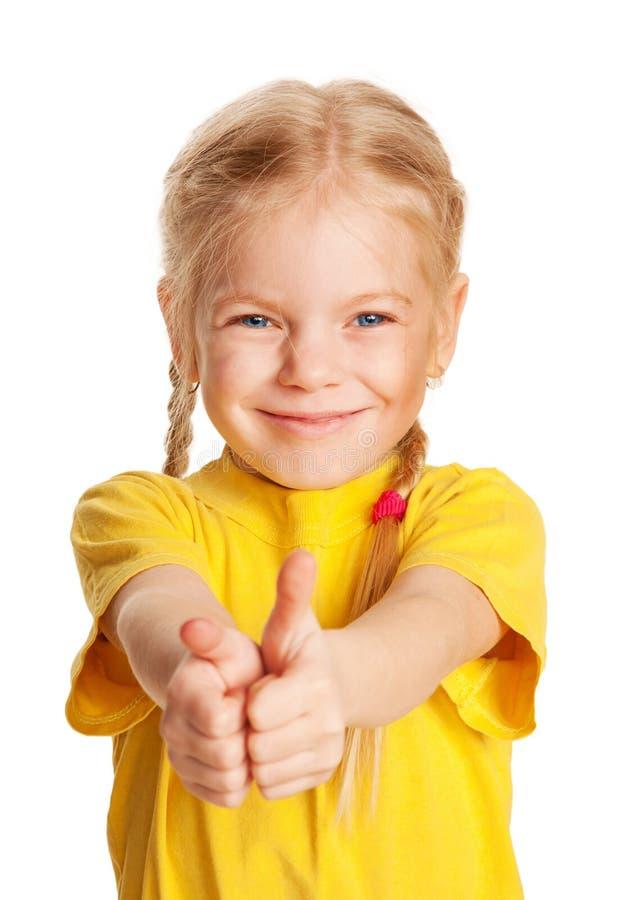 Ragazza sorridente che mostra i pollici su o simbolo GIUSTO. immagini stock libere da diritti